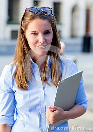Female student with a laptop