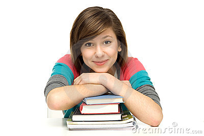 Female student leaning on bookslaptop
