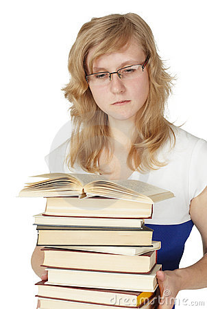 Female student with pile of books