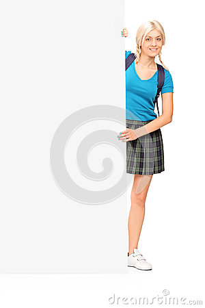 Female student posing behind a panel