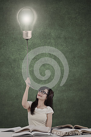 Free Female Student Pulling Bright Lamp Stock Photography - 42228692