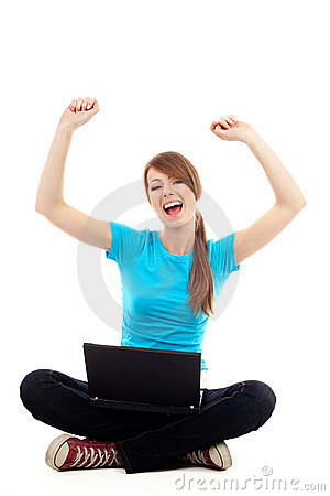 Female student raise arms sitting with laptop
