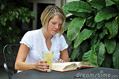 Female Student Studying with Textbook