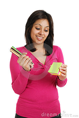 Female student about to write on post its notes