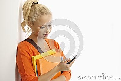 Female student using mobile phone