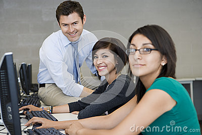 Female Students With Professor In Computer Lab