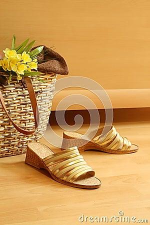 Female summer footwear, bag and flowers