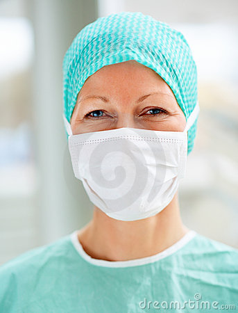 Female surgeon with a face mask
