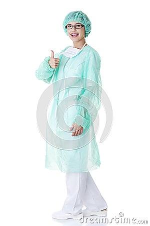 Female surgeon or nurse gesturing OK