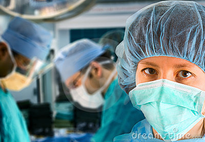 Female surgeon with surgical team