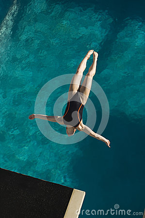 Female Swimmer Diving In Midair