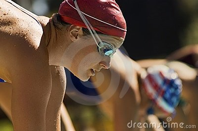 Female swimmers on starting blocks