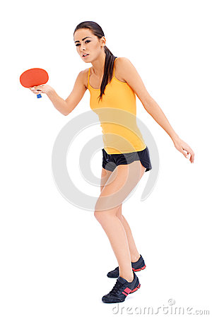 Female tabne tennis player ready to serve