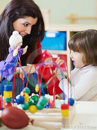 Free Female Teacher And Little Girl Playing Stock Photography - 13466452