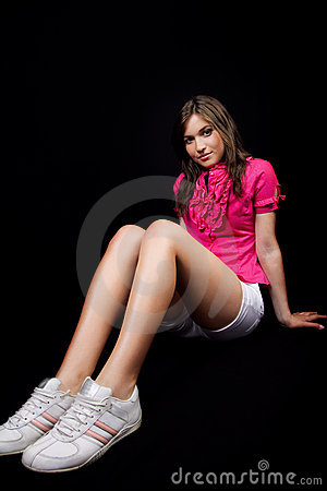 Female teen with long legs and sport shoes