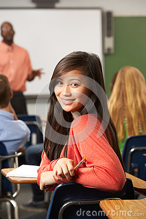 Female Teenage Pupil In Classroom Stock Photography ...