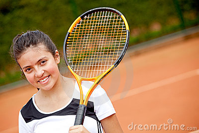 Female teenager playing tennis