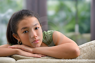 Female teenager on sofa at home