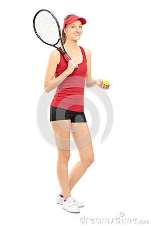 Female tennis player holding a racket and ball
