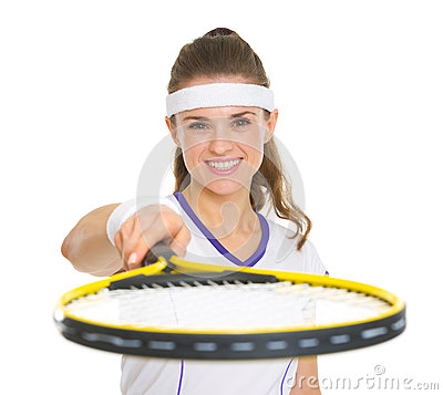 Female tennis player pointing racket in camera