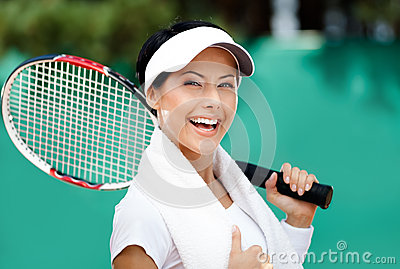 Female tennis player with towel on her shoulders