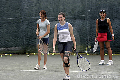 Female tennis players laughing