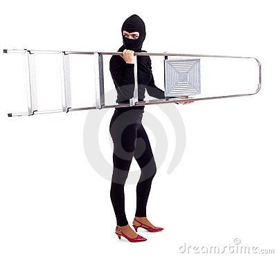 Female thief in balaclava keeping ladder