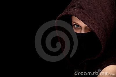 Female thief in mask and hood