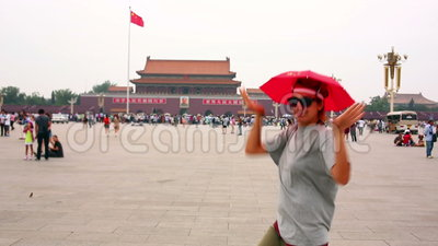 Female tourist at Beijing, China. Female tourist wearing hat with chinese flag making funny faces at Beijing, China stock video footage