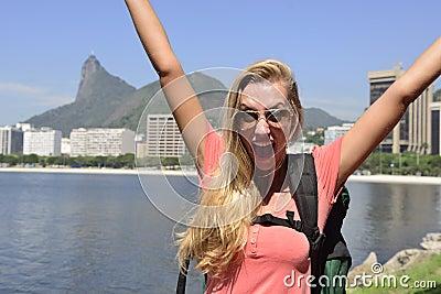 Female tourist traveling at Rio de Janeiro with Christ Redeemer.