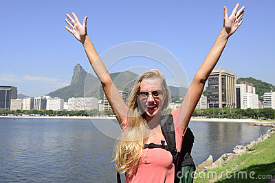 Female tourist traveling at Rio de Janeiro with Christ Redeemer.