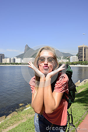 Female tourist traveling at Rio de Janeiro with Christ the Redeemer.