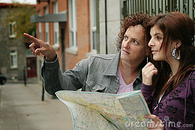 Female tourists orienteering