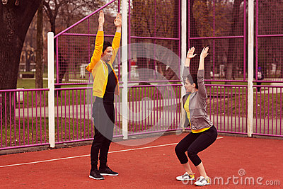 Female trainer with man exercising