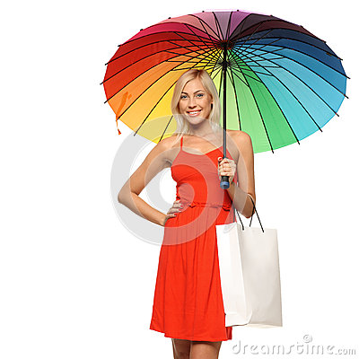 Female under umbrella holding shopping bags