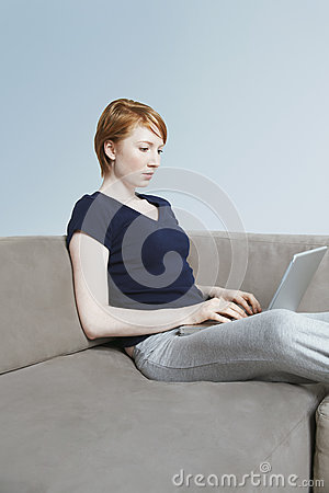 Female Using Laptop At Home