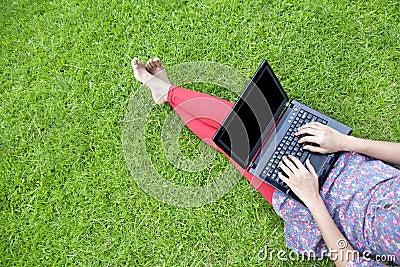 Female using laptop outdoor