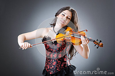 Female violin player on the background