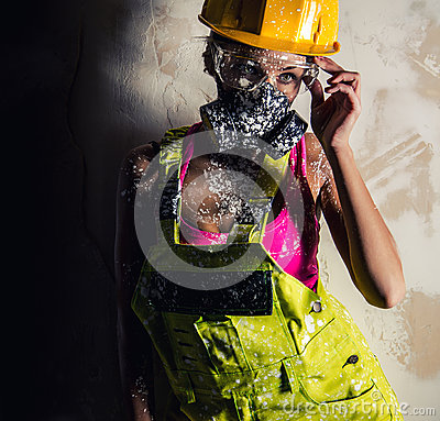 Female wearing a respirator posing indoors