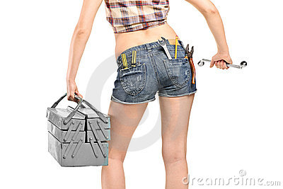Female worker holding a wrench and tool box