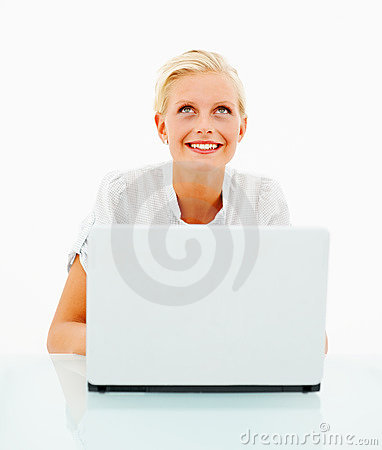 Female working on a laptop against white