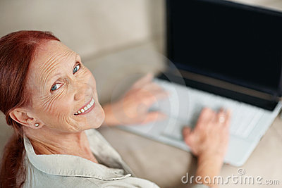 Female working on laptop while looking at you