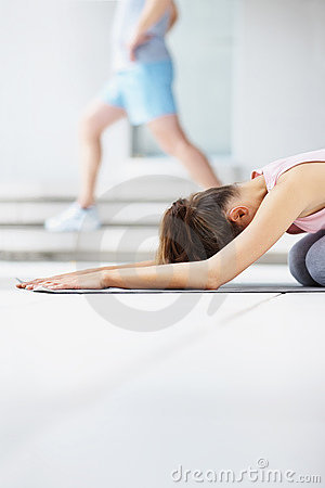 Female working out on a yoga mat at the gymnasium