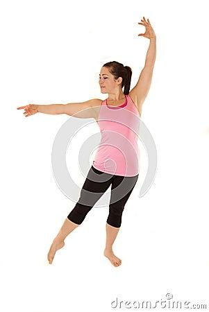 Female yoga instructor during warm ups