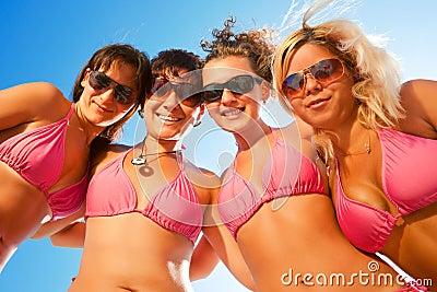 Females in bikinis on the beach