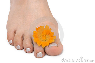 Females feet with yellow flower