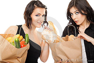 Females holding shooping bags groceries