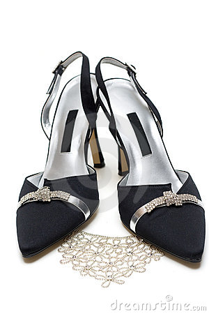Feminine black loafers and necklace