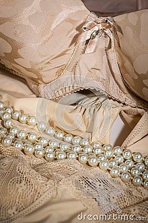 Feminine bra and beige underclothes