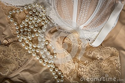 Feminine bra, perlas and underclothes